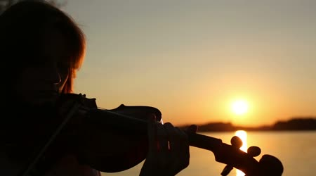 depositphotos_63626537-stock-video-female-violinist-playing-the-violin